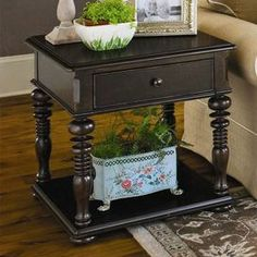 """Turned end table with 1 drawer and an open display shelf. Product:  End table Construction Material:  WoodColor:  TobaccoFeatures: Part of the Paula Deen Home CollectionDistressed finish One drawerOpen display shelf    Dimensions: 26"""" H x 26"""" W x 24"""" D"""