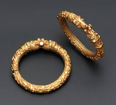 A PAIR OF ANTIQUE MAKARA HEAD BANGLES Each hinged gold bangle finely engraved to depict foliate motifs to the front, the reverse engraved in a cross-hatch pattern to the makara-head terminals with ruby detail, South Indian, early century, inner diameter Gold Bangles Design, Gold Jewellery Design, Gold Jewelry, Jewelery, Fine Jewelry, Designer Bangles, Jewelry Rings, Silver Bracelets, Bangle Bracelets