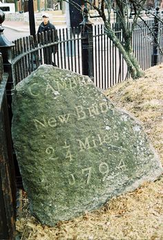 Mile marker in Cambridge cemetery on Garden Street in Harvard Square. DiscoverHarvardSquare.com.