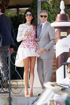 Amal Alamuddin (in Giambattista Valli Haute Couture) and George Clooney - Their wedding was the talk of the year, as everyone wanted to dissect the future Mrs. Clooney and figure out just how she nabbed the world's (former) most elusive bachelor. An international human rights attorney with a flair for fashion who is just as composed in the court room, she had us equally smitten with her style. Together, these two are destined to be Hollywood royalty—and potentially—conquer the political and…