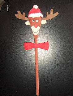 Reindeer made from a wooden spoon. Kids art project.