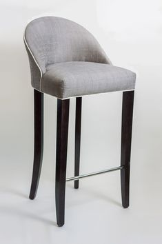 Gabrielle bar stool, Dining Chair Company.  £604, 1.5m COM. Piping, nail trim, wood staining to match swatch all available. Height 106cm x Seat width 49cm x Seat depth 40cm. 6-8 week lead