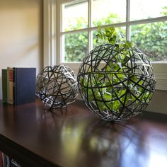 Set if two metal sphere sculptures in a tarnished champagne finish; Garden Accessories, Office Decor, Gift Shop, Metal Ball, Accent Pieces, Decorative Accessories, Accent Decor, Shelf Decor, Home Decor