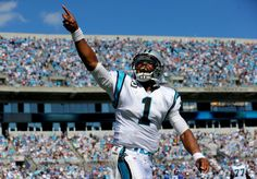 CHARLOTTE, NC - SEPTEMBER 22: Cam Newton #1 of the Carolina Panthers celebrates after scoring a touchdown against the New York Giants during their game at Bank of America Stadium on September 22, 2013 in Charlotte, North Carolina. (Photo by Streeter Lecka/Getty Images)