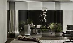 sliding doors velaria design Giuseppe Bavuso //structure in brushed lead and grey transparent glass