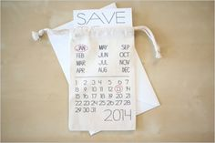Save the Date Calendar Bag. Pop a Save The Date card inside or use as favour bags filled with treats. Either way, your guests will have an eco-friendly reusable bag that will always remind them of your big day {and will ensure they never forget your anniversary!} Result!