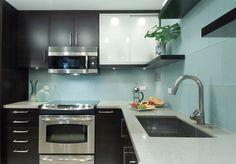 modern kitchen design, dark cabinets, light countertop, aqua blue tile backsplash, large format tile backsplash