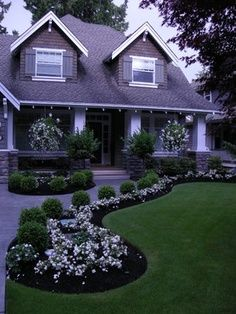 Boxwood & white flowers & the soft rounded lines of the beds. Front entrance. Flower border. Curb appeal.