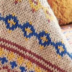 A heritage baby blanket with its subdued tones of colour worked in Fair Isle make this a wonderful keepsake that will keep precious ones all cuddled up and warm, with the choice of colours giving the blanket a naturally vintage feel.
