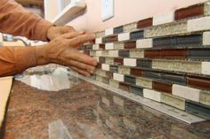 This Old House general contractor Tom Silva demonstrates a fast, no-fuss way to tile a kitchen backsplash. (See below for tools and a shopping list. Kitchen Backsplash Peel And Stick, Glass Mosaic Tile Backsplash, Install Backsplash, Mosaic Glass, Backsplash Ideas, Home Design, Küchen Design, Blue Glass Tile, Glass Tiles