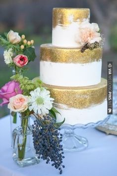 what an amazing wedding cake!  add some purple flowers and Voila!!