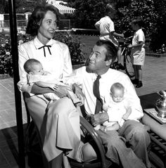 Jimmy Stewart with his wife Gloria and twin daughters Judy and Kelly (born 7 May 1951)