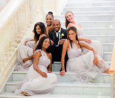 Great picture of the groom with the bridesmaids DeanSandersonWeddings.com