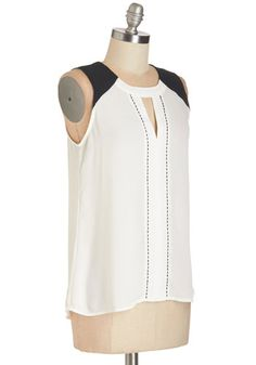 When it comes to making music, you've got the know-how - and in this breezy white top, you feel especially inspired. Just like your graceful songs, this sleeveless top hits the right notes with contrasting black shoulders, matching beaded trim, and a dulcet triangular cutout.