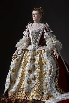 Queen Charlotte was a patroness of the arts, known to Johann Christian Bach and Wolfgang Amadeus Mozart, among others. She was also an amateur botanist who helped establish Kew Gardens. Queen Charlotte and King George III had 15 children, 13 of whom survived to adulthood. Here she is shown in coronation robes.