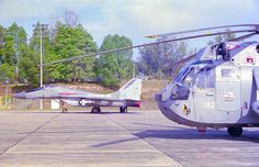 "From the Archives:  Royal Malaysian Air Force RSK MiG-29N Fulcrum with UK's Royal Navy's Sikorsky S61 Sea King. Participants of 1997 ""Excercise Flying Fish"", held in Malaysia.     Great"