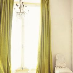 //long curtains maybe? instead of the roll downs. Chartreuse drapes hit the amazing herringbone flooring in this dramatic space. Velvet Drapes, Silk Curtains, Long Curtains, Green Curtains, Curtains Living, White Curtains, Hanging Curtains, Blinds Curtains, Roman Curtains