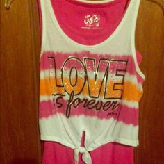 """""""Love is Forever"""" tank(item of the day!!) White crop top over a full length pink tank(attached) white part says """"love is forever"""" with pink/orange lines for kids. WILL BE DONATED BY THE END OF THE YEAR IF NOT BOUGHT!!!!!!                                                           Smoke free home that has 1 small dog.            May be wrinkly when delivered to you             Bundle and make offers Justice Tops Tank Tops"""