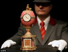 Exquisite: The Rothschild egg, with guard, at Christies in London, where it was sold in 2007 for £8.9 million