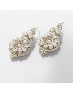 MEG JEWELRY | Candlelight couture bridal statement earrings by MEG Jewelry encrusted with Swarovski crustals and freshwater pearls on ear wire for pierce ears