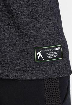 Fast so schnell wie der 100 Meter-Weltmeister! Puma EVOSTRIPE - T-Shirt print…