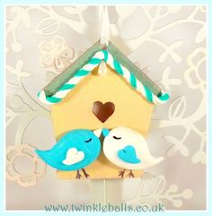 TWO LITTLE LOVE BIRDS hanging decoration. Handmade Polymer clay love birds presented on a ply wood bird house cut out. PRICE - £10 plus £5 p&p