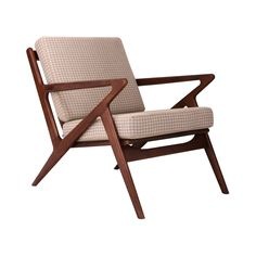 Sit back and relax—you've found the perfect chair! Inspired by an iconic mid-century design, this armchair mixes an energetic frame of sleek walnut-finished ash with a comfortably padded seat you can r...  Find the Zahra Armchair, as seen in the The Bohemian Minimalist Collection at http://dotandbo.com/collections/the-bohemian-minimalist?utm_source=pinterest&utm_medium=organic&db_sku=104252