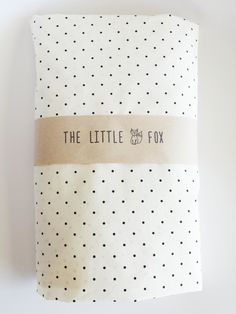 This listing is for an Ivory / black spot fitted cot sheet to fit the Stokke Sleepi Cot. It has a seamed edge and elastic around the entire