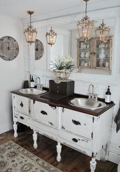 Bathroom reveal day which we accomplished turning an antique buffet into a bathroom and added shiny silver sinks and antique pendant lighting