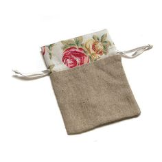 Mini Linen Drawstring Pouch with English Tea Rose Decorative Trim The romantic nature of this drawstring bag makes it ideal for a rustic or vintage wedding. The classic rose print embellishes the simp