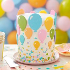 This cake is ready to take off for birthday fun! Decorated with colorful candy balloons, this Birthday Balloon Cake is perfect for first birthday parties. Use Candy Melts candy to make the balloons and the sprinkle confetti, then top your cake with a cand Wilton Cakes, Candy Melts, Mini Cakes, Cupcake Cakes, Cupcakes, Smooth Cake, Ice Cake, Balloon Cake, Birthday Cakes