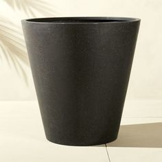 Shop shore polyterrazo extra large black planter.   Modern faux-stone planter is handmade from an innovative polystone material that resembles natural stone—both in looks and durability.  Modern conical shape and black finish accent any decor.