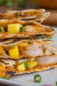 Island Shrimp Quesadillas This shrimp quesadillas recipe features perfectly ripe mango, flavorful seasonings and Mexican cheeses. Just grill for less than 20 minutes and you have a quick and easy lent or summertime recipe. Seafood Dishes, Seafood Recipes, Mexican Food Recipes, Vegetarian Recipes, Dinner Recipes, Cooking Recipes, Healthy Recipes, Recipes For Lent, Dinner Ideas