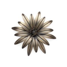 Torre & Tagus 900270 Burnished Flower Wall Décor, Medium Decorate your walls with more than just murals and paintings, consider metal flower wall art.  In addition to being beautiful floral wall art gives a room a soft vibe