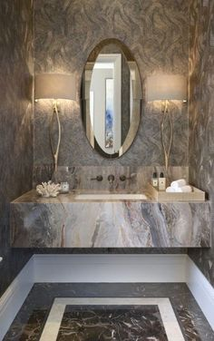 Designed by the Alexander James Interiors architectural team, this evocative cloakroom captivates with its three-dimensional fossil effect Hawksmoor wallpaper by Zoffany, the hypnotic abstract design enhancing the exquisite marble sink. Bathroom Design Luxury, Modern Bathroom, Home Interior Design, Kmart Bathroom, Houzz Bathroom, Paris Bathroom, Zen Bathroom, Lobby Interior, Mirror Bathroom