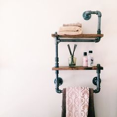 Inspired by my love for steampunk. This piece is great for a kitchen or bathroom, complete with two shelves for storage and a towel rack. Made