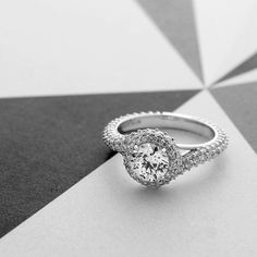 Reflect your everlasting love eternal swirling silhouette of Devotion's Alexandria engagement ring--a modern pave modern pavé setting with 176 sparkling, Forevermark-certified diamonds. This statement piece is certain to turn heads.