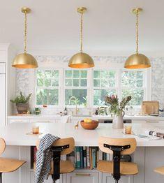Kitchen island, bookshelves under seating