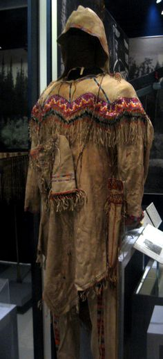 """Late 19th century Athapaskan (First Nations) Man's outfit at the Royal Ontario Museum, Toronto - From the curators' comments: """"This type of summer outfit with pointed-hem tunic and moccasin-trousers had a wide distribution in the northern Athapaskan region including Alaska, Yukon, and the Northwest Territories. Embellished with seeds, porcupine quill embroidery and glass beads, richly decorated clothing reflected a man's wealth."""""""