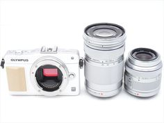 Near Mint! Olympus E-PM2 16MP with 14-42mm  40-150mm White  1 year warranty