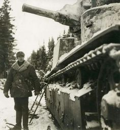 Finnish soldier with an abandoned T-28 tank.