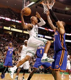 Boston Celtics' Ray Allen looks for an opening around New York Knicks' Tyson Chandler during the first quarter of an NBA basketball game in Boston on Friday, Feb. 3, 2012.