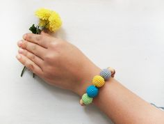 Varicolored Bracelet with wooden rings/ by LittleSweetCandyShop, $13.00