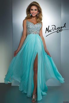 Mac Duggal Style 64364A - Peek a boo cut outs add the spicy flavor to this classic prom gown.  Ciffon overlay on satin and fully beaded bodice with high leg slit is sweet and sexy in one.