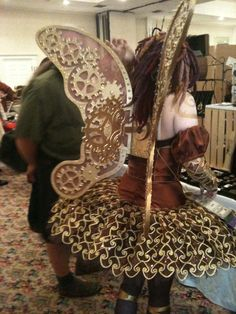Amazing Steampunk fairy. Those wings are all carved from foamboard!