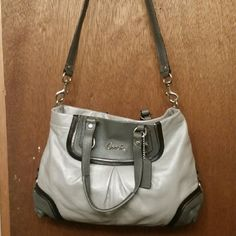 Coach purse Beautiful grey coach purse with baby pink inside!! Brand new, never used! Coach Bags Shoulder Bags