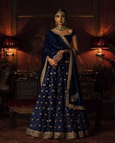 This blue colour wedding lehenga is in silk velvet fabric embroidered with dabka stone beads kasab and sequins. Shawl is also in silk velvet of blue color with four-sided marodi border and motifs on the corners. Indian Wedding Outfits, Bridal Outfits, Indian Outfits, Bridal Dresses, Ceremony Dresses, Designer Bridal Lehenga, Indian Bridal Lehenga, Mode Bollywood, Bollywood Fashion