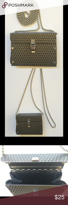 """Super Cute & Unique Tiny Purse Hand-Crafted of metal and rubber, this unique and well-made tiny purse was purchased in a Nantucket boutique.  It has only been used a handful of times, and I'm letting it go to make room in my closet.  It measures 4.5"""" x 3.5"""" x 1.5"""". With a strap drop of 25"""". Smoke-Pet/Free Owner. Boutique Bags Mini Bags"""