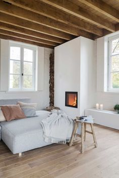 whitewashed modern interior with fireplace, daybed and exposed wood beam ceilings. Living Area, Living Spaces, Living Room, Interior Desing, Interior Ideas, Wood Beams, Wood Beamed Ceilings, Scandinavian Home, Minimalist Decor