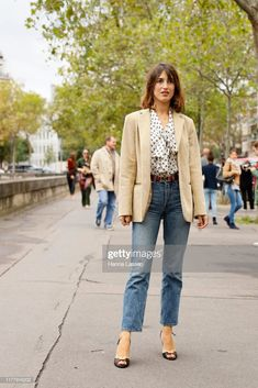 Jeanne Damas wearing beige jacket and jeans outside Valentino during...- Getty Images